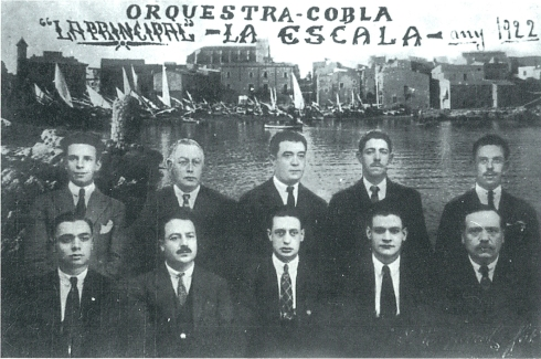 La Principal de l'Escala, 1922. Martí Jonama, Francesc Sala (pare), Ramon Tasis, ?, Joan Esponellà, Joan Puig, Josep Maria Vilà, Francesc Sala (fill), Josep Ferrer i Adolf Tasis